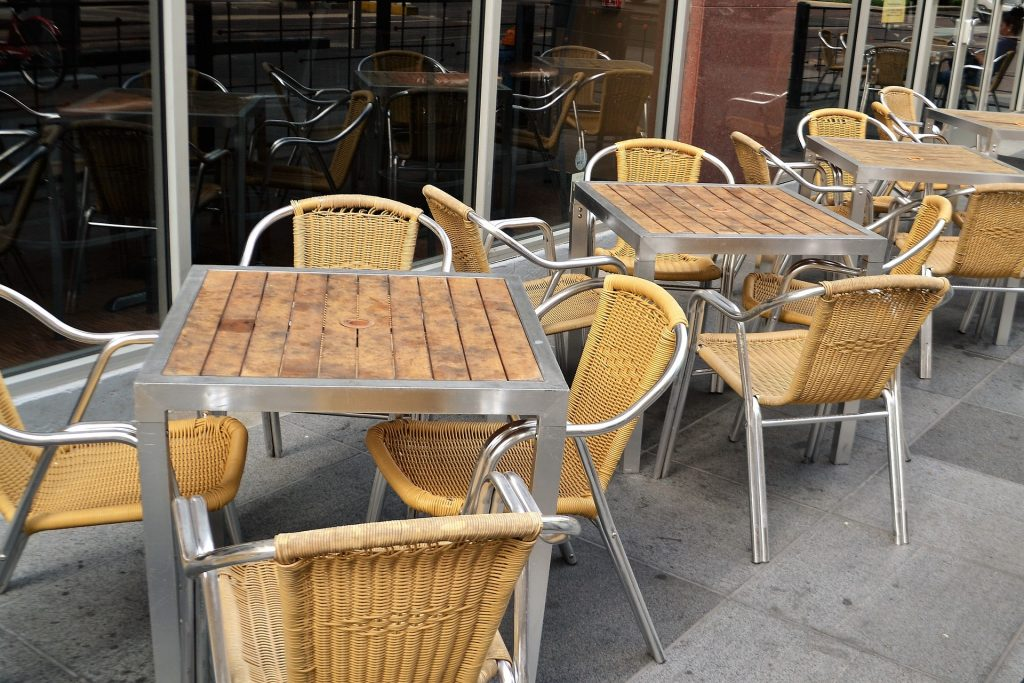 image of cafe chairs and tables with no patronage at cafe